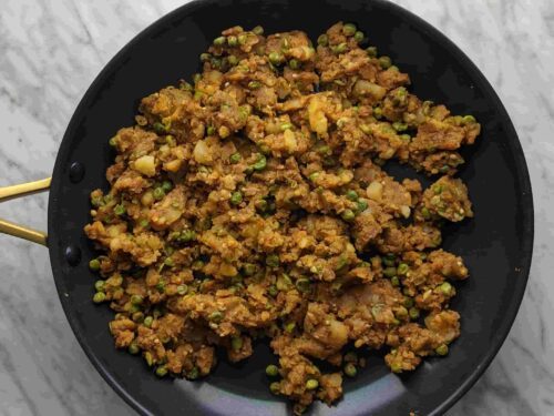 Mix in boiled potatoes with spices