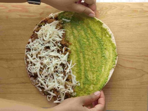 Layer tortillas with chutneys, samosa filling and cheese