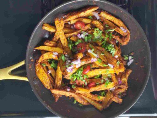Toss potatoes in masala sauce